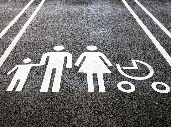 A designated parking spot at a supermarket intended only for families.